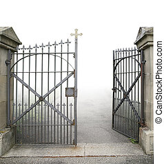 entrance of a graveyard with a open wrought-iron gate in gradient back and clipping path