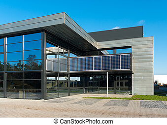 entrance of a modern office building with solar panels for energy supply