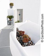 Entrance of a white beautiful house. Santorini island Cyclades, Greece.