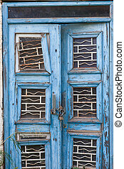 Entrance of abandoned house - Peeling blue paint on exterior...