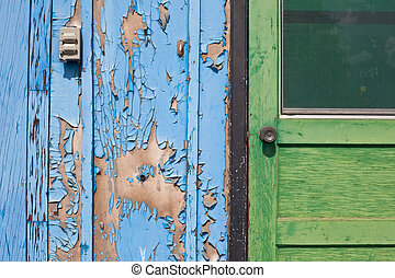 Entrance of abandoned house - Peeling paint on exterior door...