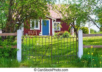 Entrance of red wooden cottage in Sweden - Entrance of a...