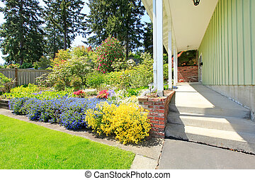 Entrance porch blooming flower bed