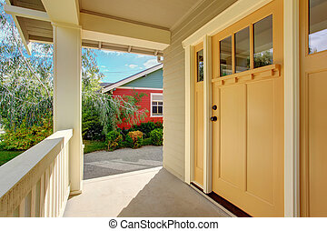 Entrance porch with light yellow door