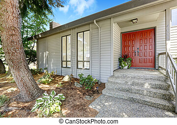 Entrance porch with red door