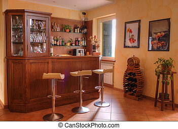 the entrance of a house with wet bar