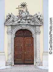 Entrance to a church in Budapest, Hungary. Wooden door with...