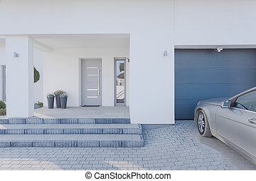 Horizontal view of entrance to detached house