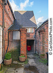 Entrance to generic English brick home in a small town in Surrey, South England