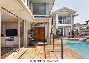 entrance to luxurious australian mansion - entry way to...