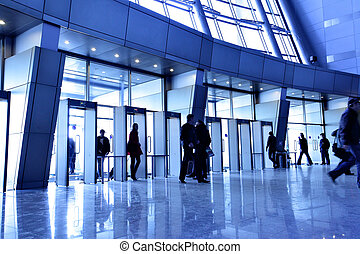Entrance to modern building and people silhouettes