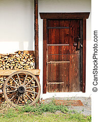 Entrance to old farmhouse in the countryside in Austrian Alps