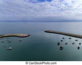 Entrance to the fishing harbor seaport in Albufeira. Algarve.