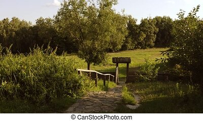 Entrance to the forest. Rustic wooden doors with hedge. ...