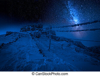 Entrance to the top in the winter mountains at night