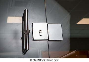 door with steel handles - entrance with glass door with...