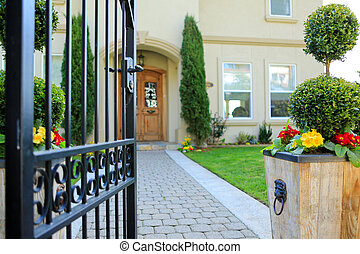 Entrance wrought iron gate to luxury house - Open entrance...