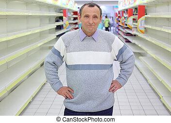 entre, étagères, stands, homme âgé, vide, magasin