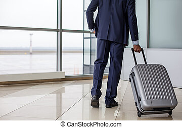 Entrepreneur is carrying his luggage