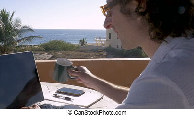 Entrepreneur man drinking coffee writing and working on...