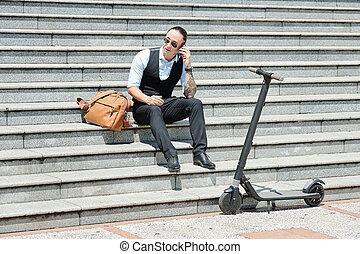Entrepreneur sitting on steps