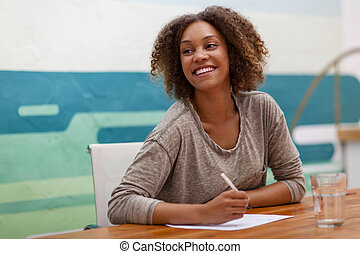 Entrepreneur smiling at an office table