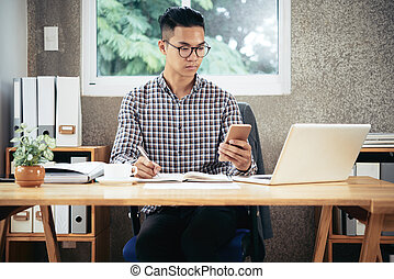 Entrepreneur Working at Office Desk
