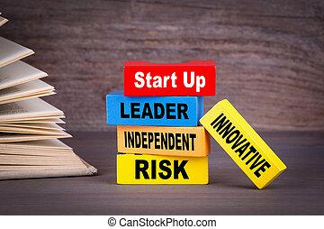 Entrepreneurship concept. Colored wooden blocks on the table