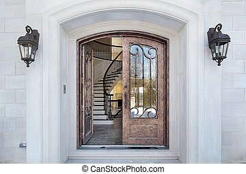 Entry and arch of home - Entry and door with arch and...