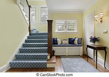 Entry area with yellow walls - Entry area of luxury home...