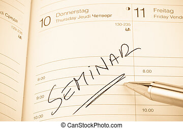 entry in the calendar: seminar - a date is entered in a...