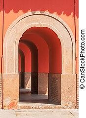 Entry of a red arch corridor in a chinese gate