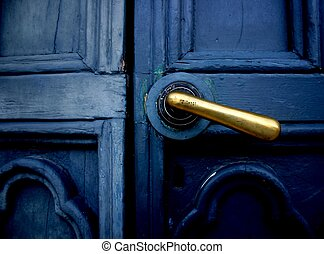 Entry - Old blue closed door in bad condition with polish...