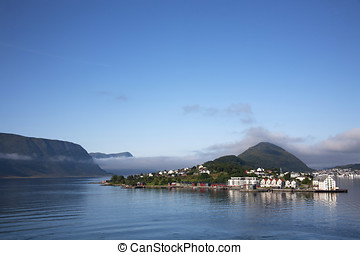 Entry waterway to Alesund Norway with historic homes and buildings