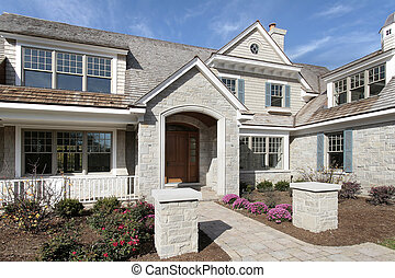 Entry way of stone and cedar home