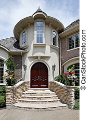 Entry way of luxury home with stone steps