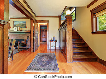 Entryway with wooden staircase and hardwood floor