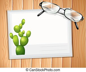Envelop with a cactus design and a pair of eyeglasses on it