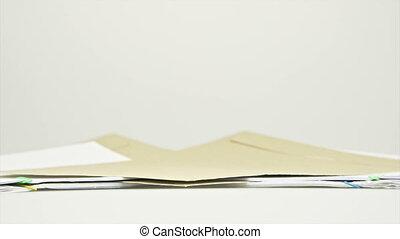 Envelope between stack paper report of sales and receipt...