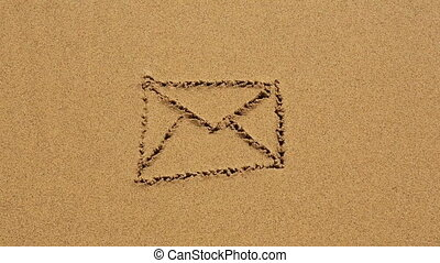Envelope drawn in the sand at the beach. hd.