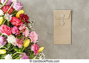 Envelope next to flowers bouquet