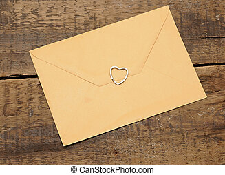 envelope on wooden background and heart.