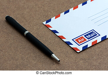 Envelope on wooden background,