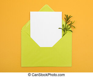 Envelope with blank card on bright yellow background