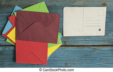 Envelope with card on wooden background