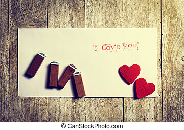 Envelope with message I love you and hearts on a wooden background. Love concept
