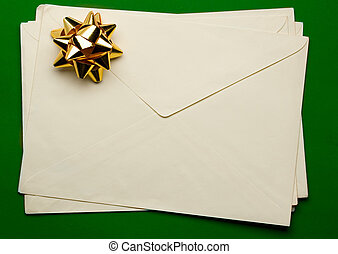 Envelope with ribbon isolated on green background