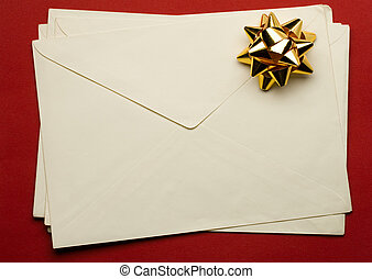 Envelope with ribbon isolated on white background