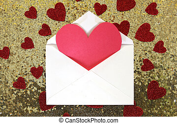 Envelope with Valentine's Day Heart Note and Confetti on Gold Sequin Background