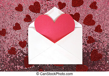 Envelope with Valentine's Day Heart Note and Confetti on Pink Sequin Background